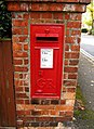 George V wall mounted postbox, Pit Farm Road - geograph.org.uk - 1551467.jpg