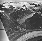 Gilkey Glacier, junction of valley glacier with band ogives, hanging glaciers, ice field, and ice fall in the background, August (GLACIERS 6337).jpg