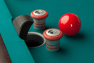 Billiard ball - Bumper pool ball near a pocket. The bumpers increase the difficulty in potting the ball.