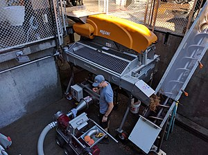 Winemaking - A mechanical destemming machine in use at Chateau Montelena winery in Napa Valley