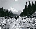 Group of hikers crossing the Nisqually River, Washington, ca 1895 (BOYD+BRAAS 29).jpg