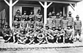 Group of men in Nome's first quota Army draft on a porch at Fort Davis, Alaska, June 22, 1918 (AL+CA 6281).jpg