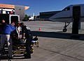 Gulfstream Air Ambulance being loaded with patient by medics and nurses for a Mercy Jets medical transport.jpg