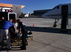 Air ambulances in the United States - A Mercy Jets crew loading a patient for transport in a Gulfstream Aerospace GIV air ambulance