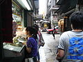 HK Sheung Wan Man Wa Lane visitors July-2012.JPG