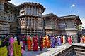 Halebid - Devotees Running through the stories on the Walls of Hoysalaswara.jpg