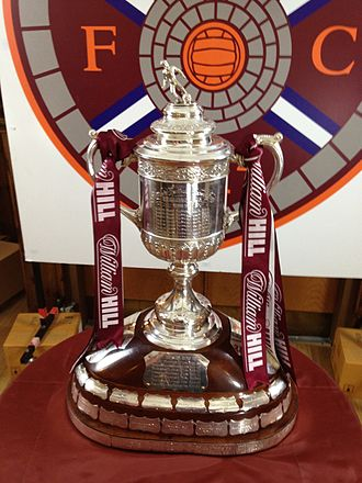 Heart of Midlothian F.C. - The Scottish Cup is the oldest national trophy in world football. Above, it is draped in maroon and white ribbons following Heart of Midlothian's 5–1 victory over Edinburgh rivals Hibernian in the 2012 final.