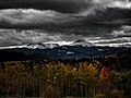 Heavy clouds over mountains and woods (Unsplash).jpg