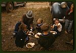 Homesteader and his children eating barbeque 1a34141v.jpg