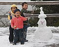 Huanglong China Children-with-almond-eye-snowman-01.jpg