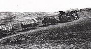 Tractor pulling ammunition wagons