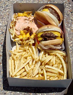 In-N-Out Burger cheeseburgers, Animal Style fries and standard fries