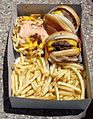 In-N-Out Burger cheeseburgers, Animal Style fries and standard fries.jpg