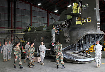 India Army Aviation officers are briefed on aircraft maintenance procedures by a U.S. Army Soldier as part of the Subject Matter Expert Exchange.jpg