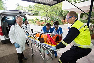International SOS - International SOS clinic staff moving a patient into their clinic in Lagos, Nigeria