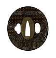 "Japanese - Tsuba with Floral Design of Overlapping Textiles (""Ho-o"") - Walters 51298 - Back.jpg"