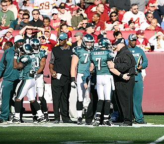 Philadelphia Eagles - Andy Reid speaks with Jeff Garcia in a game against the Redskins.