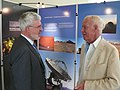 Joachim Krautter and Lodewijk Woltjer at the ESO stand at JENAM 2010 (5032633337).jpg