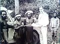 Johannes Maas with cannibals New Guinea.jpg