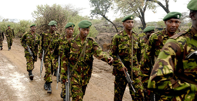 Kenyan military personnel march to Camp Great ...