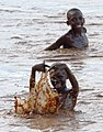 Kids bathing (11378748006).jpg