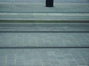 """Kassel kerb - Dresden """"Combibord"""" kerb on a tram platform"""