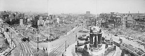 Liverpool Blitz - A panoramic view of bomb damage in Liverpool; Victoria Monument in foreground, the burned-out shell of the Custom House in middle distance