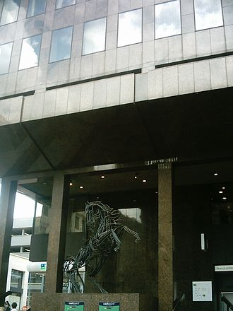 Lloyds Banking Group - Park Row Leeds branch of Lloyds Bank, with a sculpture of the black horse (called Cancara) in the foreground