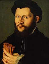Portrait of a man with gloves.