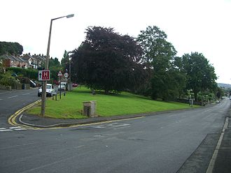 Loxley, South Yorkshire - The village green stands at the junction of Loxley Road and Rodney Hill. The Copper beech tree was planted in 1935 to mark the Silver Jubilee of King George V.