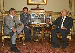 Photograph of Nabil Shaath sitting with President Lula da Silva of Brazil, speaking