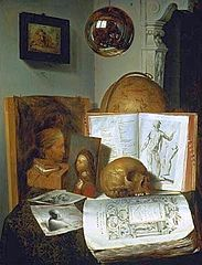 Vanitas still life with skull, books, prints and paintings, with a reflection of the painter at work