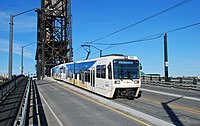 MAX train crossing Steel Bridge in 2009 - street view of SD660 LRVs.jpg