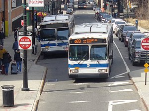 Q69 and Q100 buses - A southbound Q69 bus (right) in Queens Plaza.