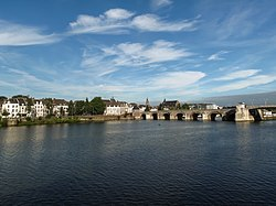 View of Maastricht city centre with its medieval bridge (Sint Servaasbrug) on the Meuse river