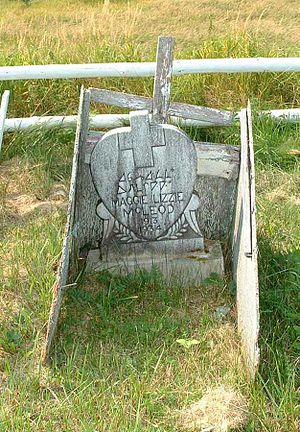 Headstone - Wood grave marker using Canadian Syllabics