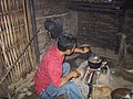 Man cooking at home in Laos.jpg