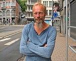 Man posing on Rue de la Station in Dinant, Belgium (DSC 0183).jpg