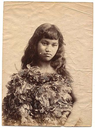 Inalienable possessions - Young Maori woman wearing a high status feather cloak indicating nobility