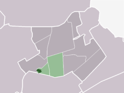 The town centre (dark green) and the statistical district (light green) of Benningbroek in the municipality of Noorder-Koggenland.