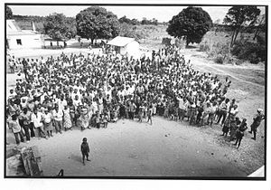 Large-group capacitation - Part of the group of 850 who took part in the 1992 Matzinho 'Field' Organization Workshop (FOW), in war-torn Mozambique