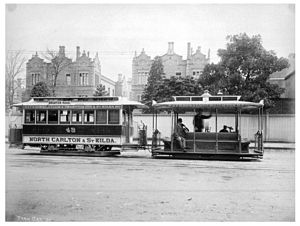 Queen Victoria Village - Cable tram dummy and trailer passing the QVH on route between Carlton and St Kilda in 1905.