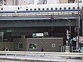 Metropolitan Subway Shinbashi station exit under girder Shinkansen(appearance).jpg