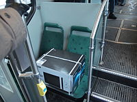 Microwave oven taking up two seats on a tram.jpg