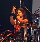 Mike Portnoy behind a line of splash cymbals