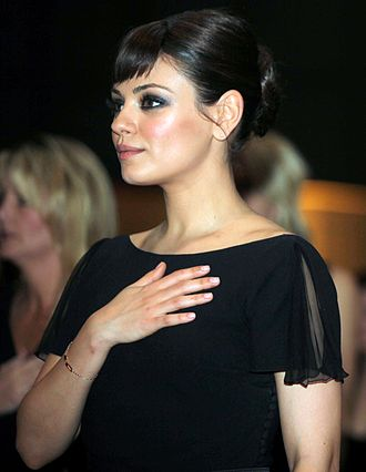 Mila Kunis - Kunis attending the Marine Corps Ball in 2011