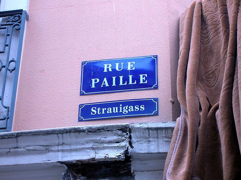 Milhüüse (Mulhouse): zweisprochi Strossaplàkàt (elsassisch, frànzesch): els: Strauigass, fr: Rue Paille