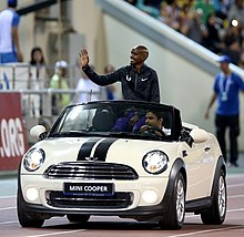 Athlete Mo Farah In A Mini Convertible At The Doha Diamond League