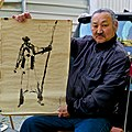 Mongol painter in Alfama (paints with red wine and coffee) (16268347311).jpg