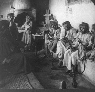 Smoking in Iraq - Men smoking hookah in Mosul, 1914